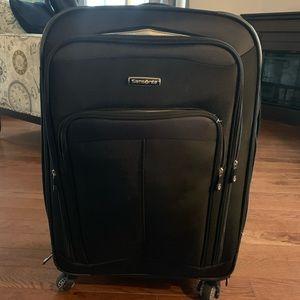 Samsonite black rolling suitcase